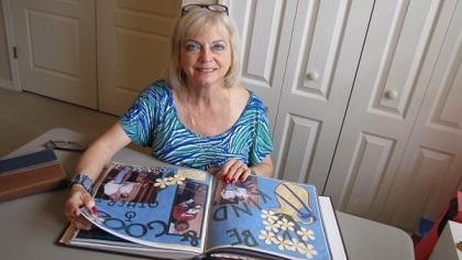 Donna Riner Weber looks at her Faithbook